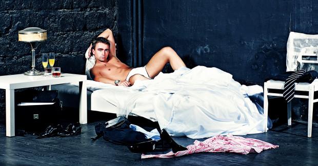 Man Reclining on Bed in Underwear